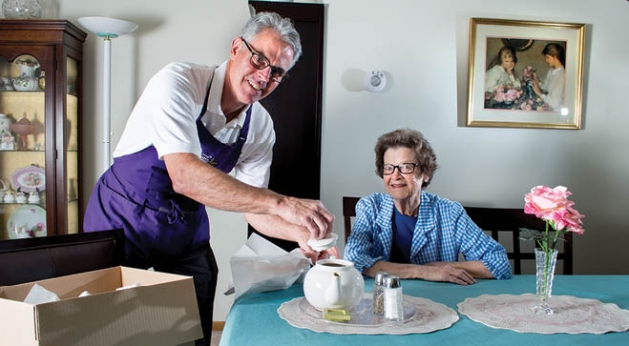 Gentle Transitions co-owner, Bill Lehman, serves tea to a new Woodbury resident.