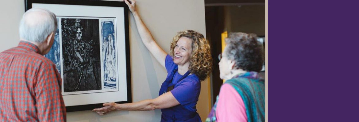 Gentle Transitions Senior Move Manager hanging pictures for clients