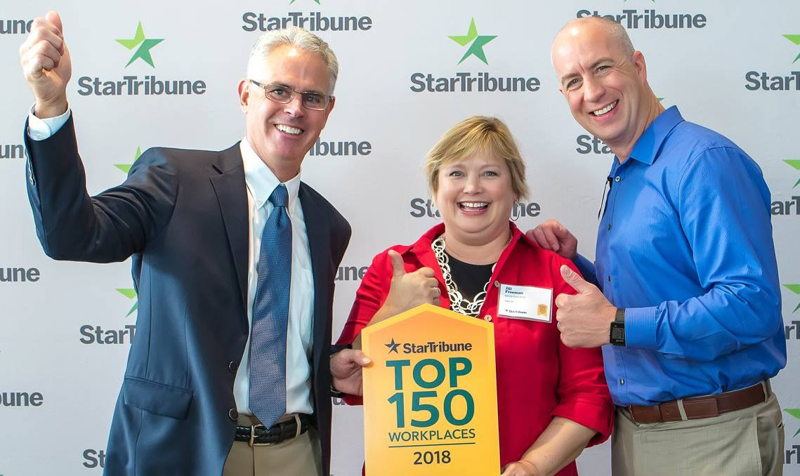 Co-Owner Bill Lehman, Marketing Associate Jill Freeman, and Managing Director Lee Syndergaard accepting the Star Tribune Top 150 award for the fifth consecutive year